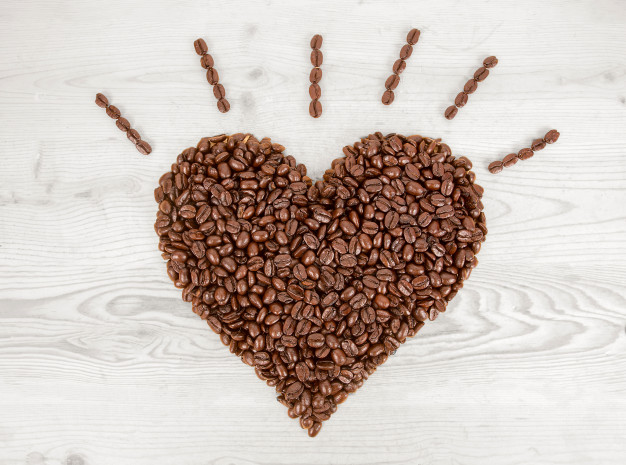 heart-shape-made-from-coffee-beans-wooden_38705-28